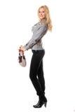 Счастливая молодая блондинка с сумкой стоковое фото rf