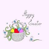Счастливая пасха с пасхальными яйцами, цветками в корзине Стоковая Фотография