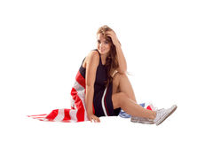 Счастливая патриотическая женщина держа флаг США Стоковая Фотография