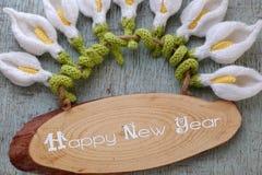 Счастливая предпосылка Нового Года, цветок лилии arum Стоковые Фотографии RF