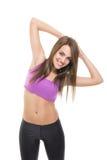 Счастливая разминка фитнеса молодой женщины пригонки Стоковые Фото