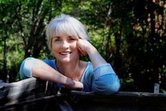 Счастливая расслабленная дама стоковые фотографии rf
