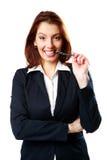 Счастливая ручка укусов женщины коммерсантки стоковое фото rf