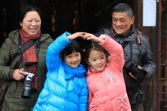Счастливая семья в перемещении Стоковая Фотография