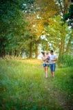 Счастливая семья идет в парк Стоковая Фотография RF