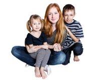 Счастливая семья на белой предпосылке Стоковое фото RF