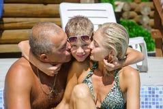 Счастливая семья на каникуле стоковые фото