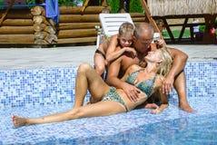 Счастливая семья на каникуле стоковые фотографии rf