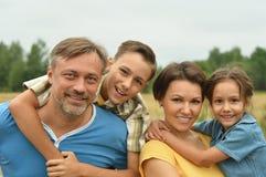 Счастливая семья на поле Стоковое фото RF
