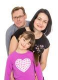 Счастливая семья дочь 7 лет старые, папа и стоковая фотография rf