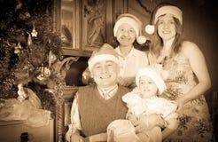 Счастливая семья празднуя рождество Стоковая Фотография
