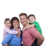 Счастливая семья с 2 детьми Стоковое Изображение RF