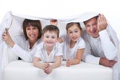 Счастливая семья с детьми стоковая фотография