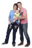 Счастливая семья с малышом Стоковая Фотография