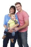 Счастливая семья с малышом Стоковые Изображения