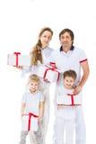 Счастливая семья с покупками Стоковые Изображения