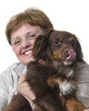 Счастливая старшая женщина с собакой стоковые изображения rf