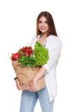 Счастливая сумка владением женщины с здоровой едой, изолированным покупателем бакалеи Стоковая Фотография