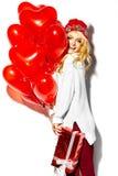 Счастливая сладостная милая усмехаясь белокурая женщина в стильных одеждах Стоковое Изображение