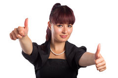 Счастливая усмехаясь бизнес-леди с большими пальцами руки вверх показывать стоковые фотографии rf