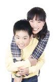 Счастливая усмехаясь молодая мать с сыном Стоковые Фотографии RF
