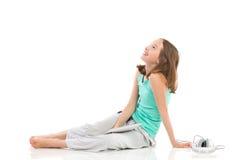 Счастливая любознательная девушка с мультимедиа Стоковая Фотография