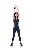 Счастливая sporty женщина делая протягивающ тренировку Стоковое Фото