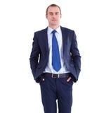 Счастливое положение бизнесмена изолированное на белой предпосылке Стоковая Фотография