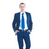 Счастливое положение бизнесмена изолированное на белой предпосылке Стоковая Фотография RF