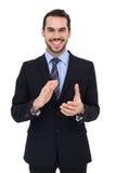 Счастливое положение бизнесмена и аплодировать Стоковые Фотографии RF