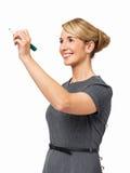 Счастливое сочинительство коммерсантки на прозрачной доске Стоковые Фотографии RF