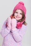 Счастливые аксессуары зимы ребенка стоковое изображение
