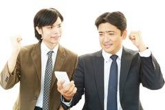 Счастливые бизнесмены Стоковые Фото