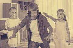 Счастливые дети играя с безпассудством Стоковое Изображение