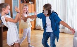 Счастливые дети играя с безпассудством Стоковое фото RF