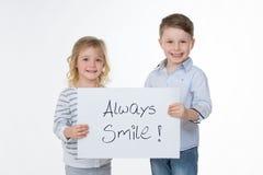 Счастливые дети на белой предпосылке Стоковое Фото