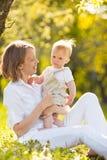 Счастливые мать и сын Стоковые Изображения