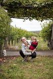 Счастливые мальчик и молодая женщина стоковое изображение rf