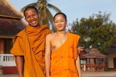 Счастливые монахи, Лаос стоковые фотографии rf