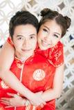 Молодые пары с платьем китайца Стоковые Фото