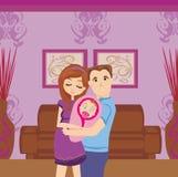 Счастливые молодые пары с Newborn младенцем Стоковое Фото