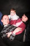 Счастливые молодые родители и маленький младенец Стоковое Фото