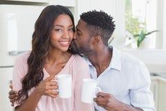 Счастливые пары имея кофе совместно Стоковые Фото