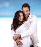 Счастливые пары на пляже Стоковое фото RF