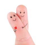 Счастливые пары обнимают при концепция цветка, покрашенная на пальцах Стоковое фото RF