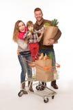 Счастливые пары с их младенцем после ходить по магазинам Стоковое Изображение