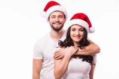 Счастливые пары с шляпой santa Стоковая Фотография