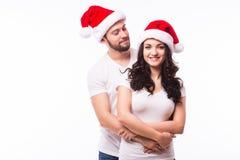 Счастливые пары с шляпой santa Стоковые Изображения