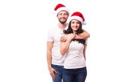 Счастливые пары с шляпой santa Стоковые Фото