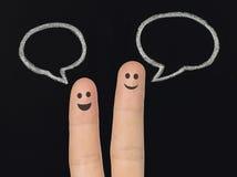 Счастливые пальцы с пузырями речи мела Стоковое Изображение RF